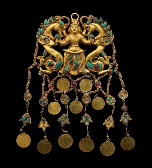 "Headdress pendant depicting a ""Dragon Master"""